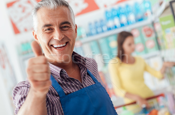 Supermarket clerk giving a thumbs up Stock photo © stokkete