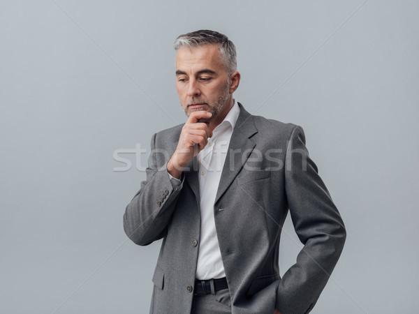 Empresário pensando mão queixo pensativo negócio Foto stock © stokkete