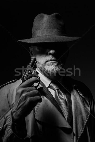 Retrato 1950 estilo detetive posando escuro Foto stock © stokkete