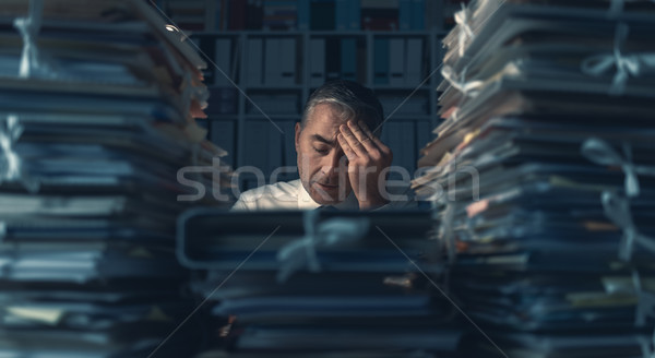 Business executive overloaded with work Stock photo © stokkete