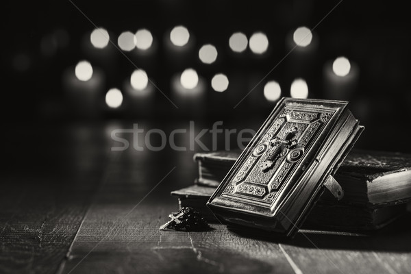 Antique precious Bible and Holy rosary in the Church Stock photo © stokkete