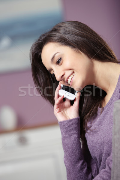 portrait of young smiling woman on phone Stock photo © stokkete