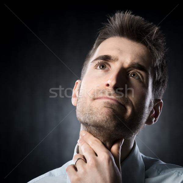 Torokfájás fiatalember megérint nyak elégedetlen férfi Stock fotó © stokkete