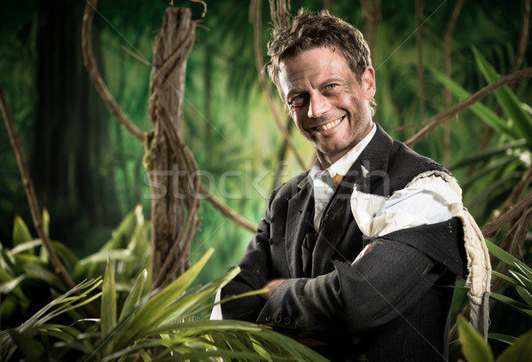 Smiling businessman in business jungle Stock photo © stokkete