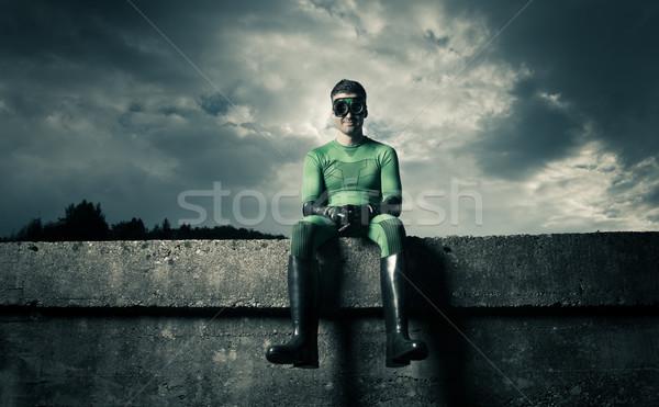 Smiling green superhero Stock photo © stokkete