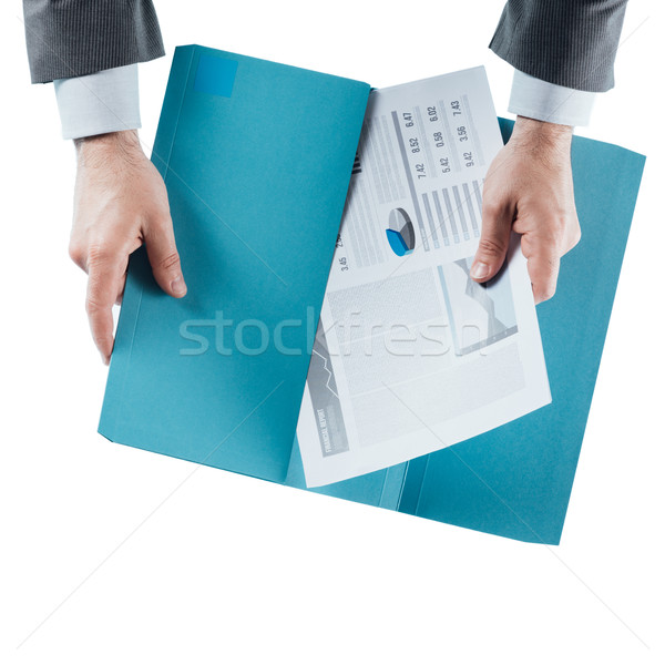 Business man checking a financial report Stock photo © stokkete