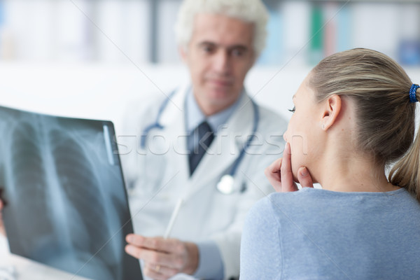 Doctor examining a patient's x-ray Stock photo © stokkete