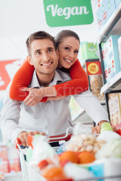 Cheerful couple doing shopping Stock photo © stokkete