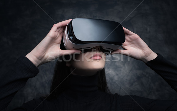 Young woman with virtual reality headset Stock photo © stokkete
