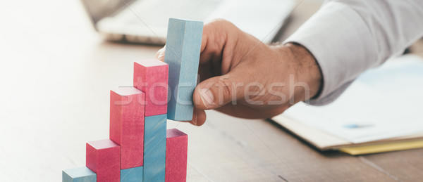 Businessman building a successful financial graph Stock photo © stokkete