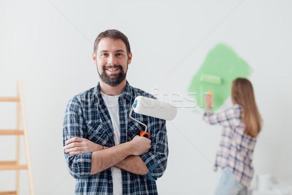 Otthon rendbehoz dekoráció dekoráció festmény férfi Stock fotó © stokkete