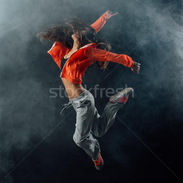 Performer dancing on dark background Stock photo © stokkete