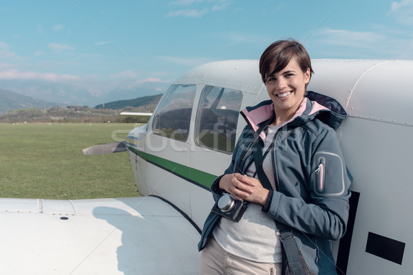 Photographer posing with a light aircraft Stock photo © stokkete