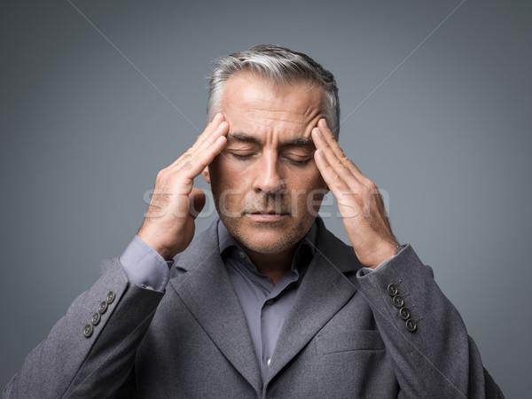 исчерпанный корпоративного бизнесмен голову рук Сток-фото © stokkete
