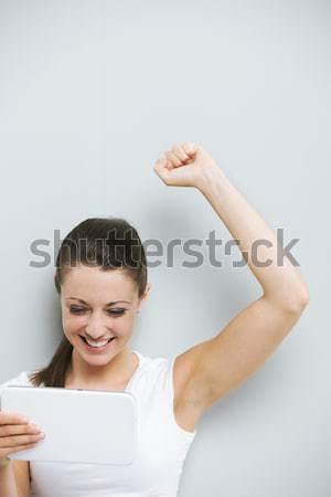 Gagner joli jeune femme bras air Photo stock © stokkete