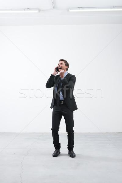 Una buona notizia telefono gioioso imprenditore pugno Foto d'archivio © stokkete