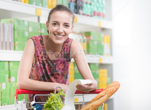 Nő nyugta áruház mosolygó nő hosszú dől Stock fotó © stokkete