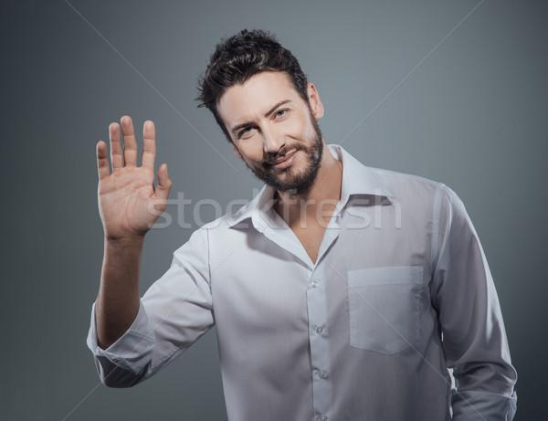 Jóképű férfi üdvözlet kéz kiemelt megbeszélés divat Stock fotó © stokkete