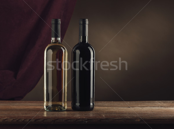 Wine bottles still life Stock photo © stokkete