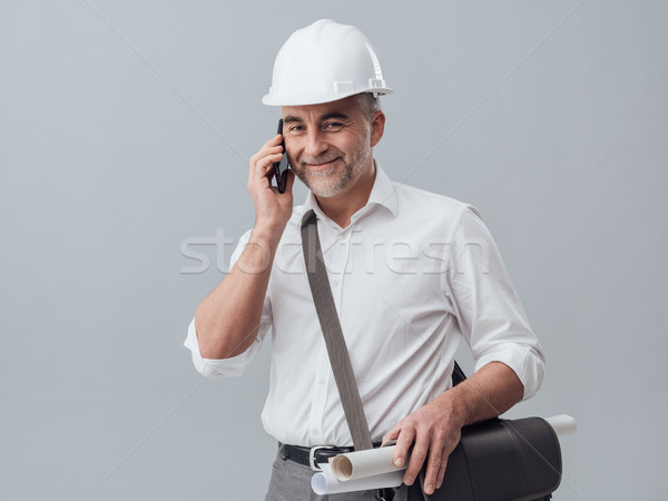 Construction engineer using a smartphone Stock photo © stokkete