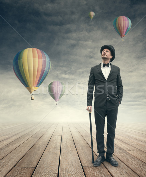 Imaginative vintage businessman with hot air ballons Stock photo © stokkete