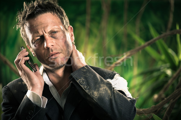 Lost injured businessman calling for help Stock photo © stokkete