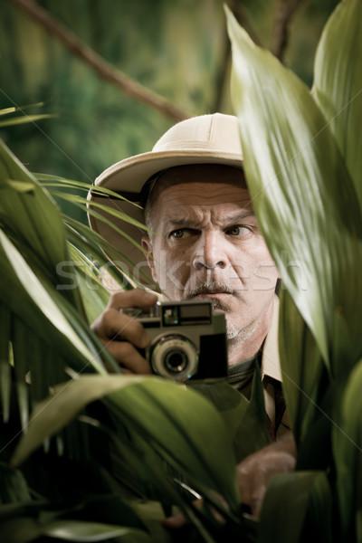 Stock photo: Explorer photographer hiding in vegetation