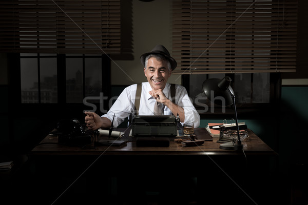 Confident journalist working late at night Stock photo © stokkete