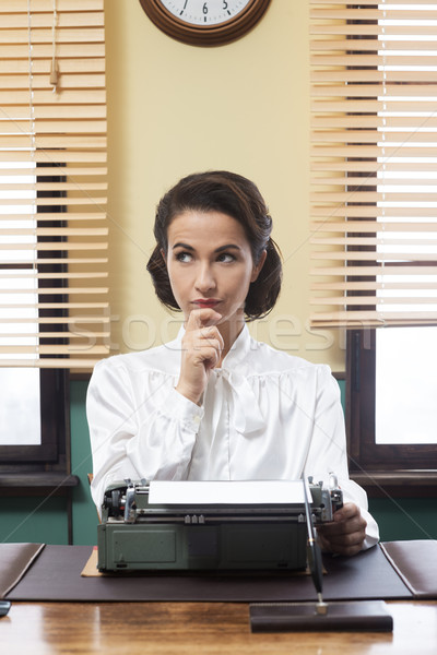 Pensive secretary with typewriter Stock photo © stokkete