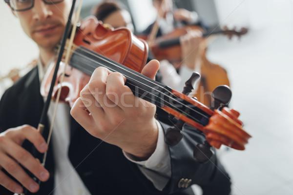 Stock photo: Violin players performing