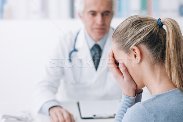 Woman receiving bad news from her doctor Stock photo © stokkete