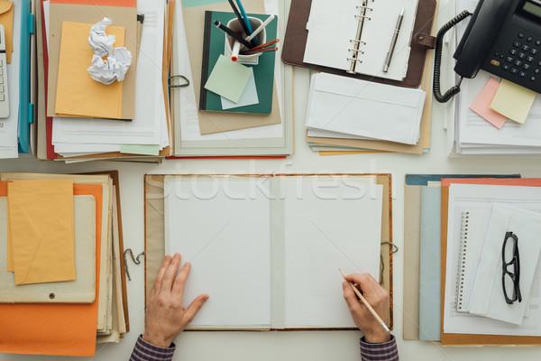 Irodai dolgozó ír papírmunka iratok mappa tele Stock fotó © stokkete