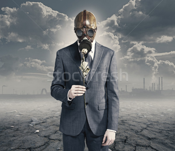 businessman with dried rose: concept polluted environment Stock photo © stokkete