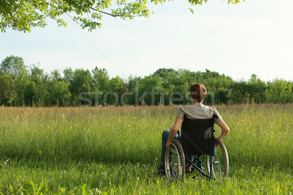 Disabled young man on the park Stock photo © stokkete