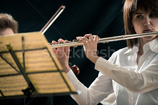 Professional flutist on stage Stock photo © stokkete