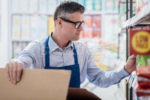 Supermarket clerk at work Stock photo © stokkete