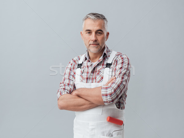 Painter posing with arms crossed Stock photo © stokkete