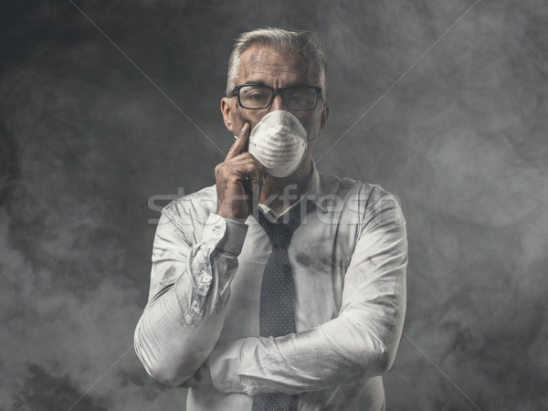 Businessman with mask and air pollution Stock photo © stokkete