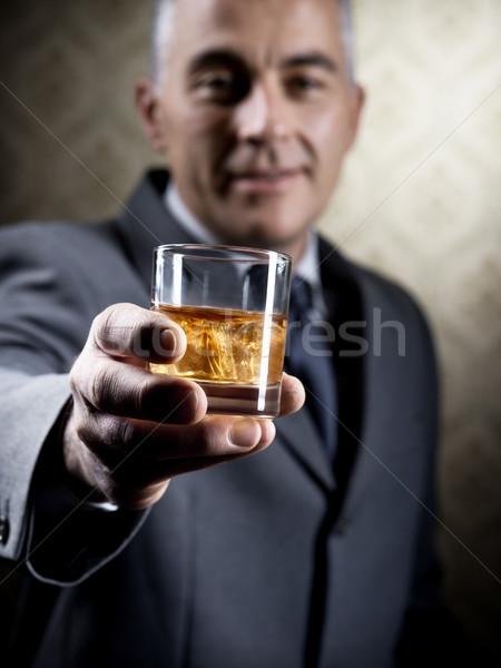 Klasszikus üzletember tart üveg whisky régi tapéta Stock fotó © stokkete