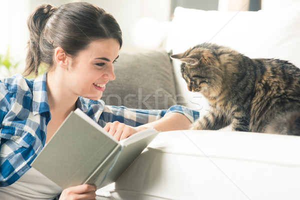 Stock photo: Woman playing with cat