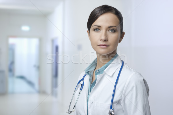 Confident female doctor with lab coat Stock photo © stokkete
