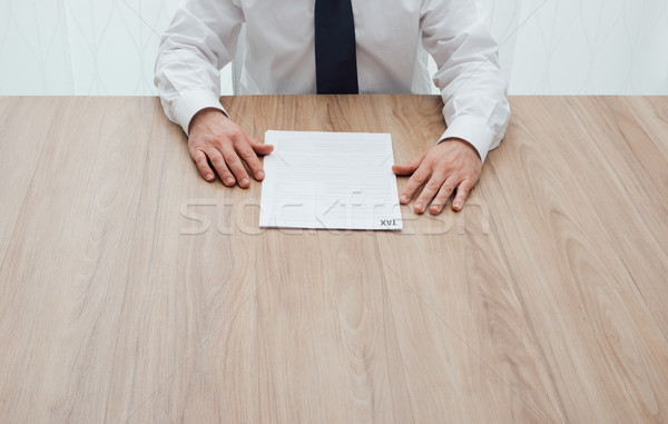 Businessman checking tax forms Stock photo © stokkete