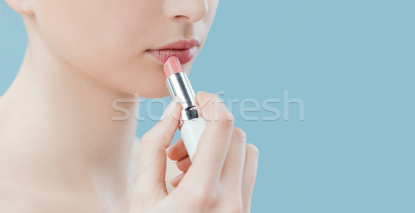 Woman applying lipstick Stock photo © stokkete