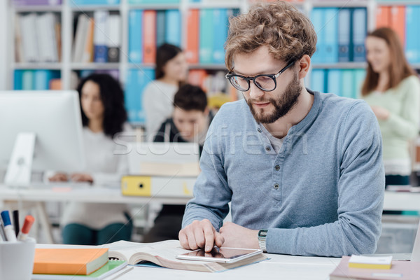 University students using a tablet Stock photo © stokkete