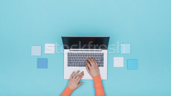 Woman working with a laptop and sticky notes Stock photo © stokkete