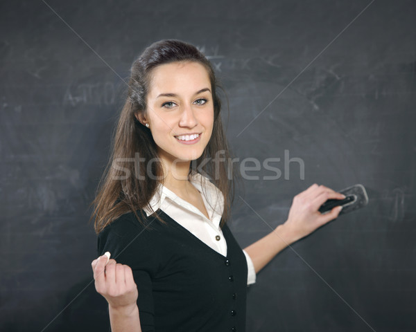 teacher Erasing The Blackboard Stock photo © stokkete
