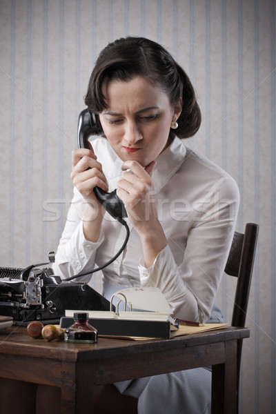 Woman talking on phone at desk Stock photo © stokkete