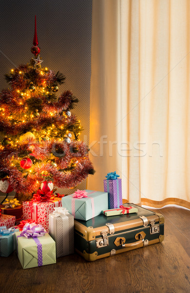 Christmas tree with gifts and old suitcase Stock photo © stokkete