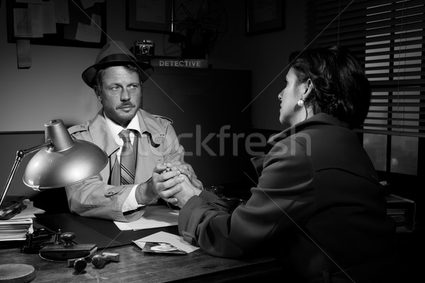 Handsome detective comforting a young scared woman Stock photo © stokkete