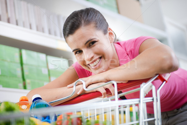 Woman with trolley at store Stock photo © stokkete